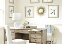 Small-sunburst-mirror-is-a-part-of-a-wall-gallery-in-a-serene-room-217x155