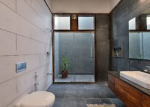 Smart-modern-bathroom-in-black-and-white-with-floating-wooden-vanity-217x155