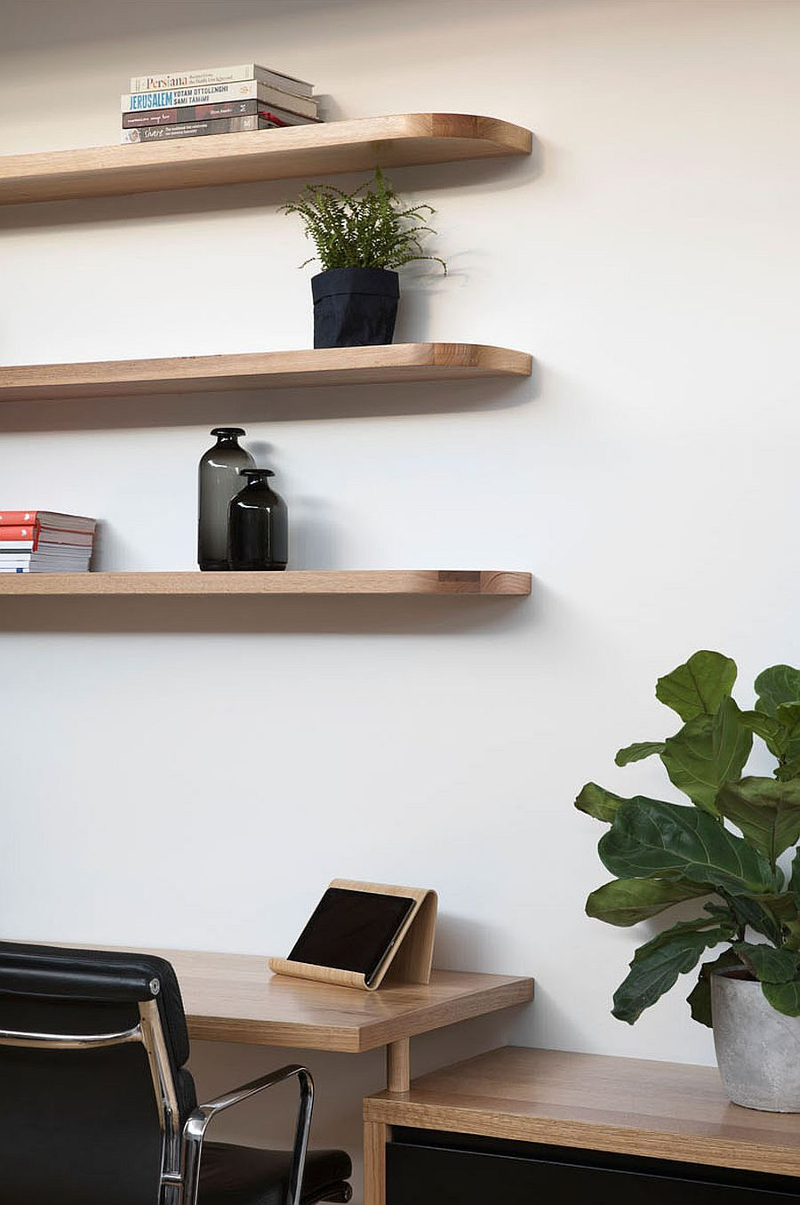 Simple floating shelves act as both decorative and practical additions