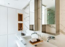 Sophisticated-modern-bathroom-with-marble-flooring-and-walls-217x155