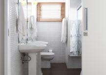 Space-savvy-modern-bathroom-in-white-with-dark-flooring-217x155