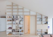 Space-savvy-wall-shelves-that-reach-all-the-way-up-to-the-ceiling-217x155
