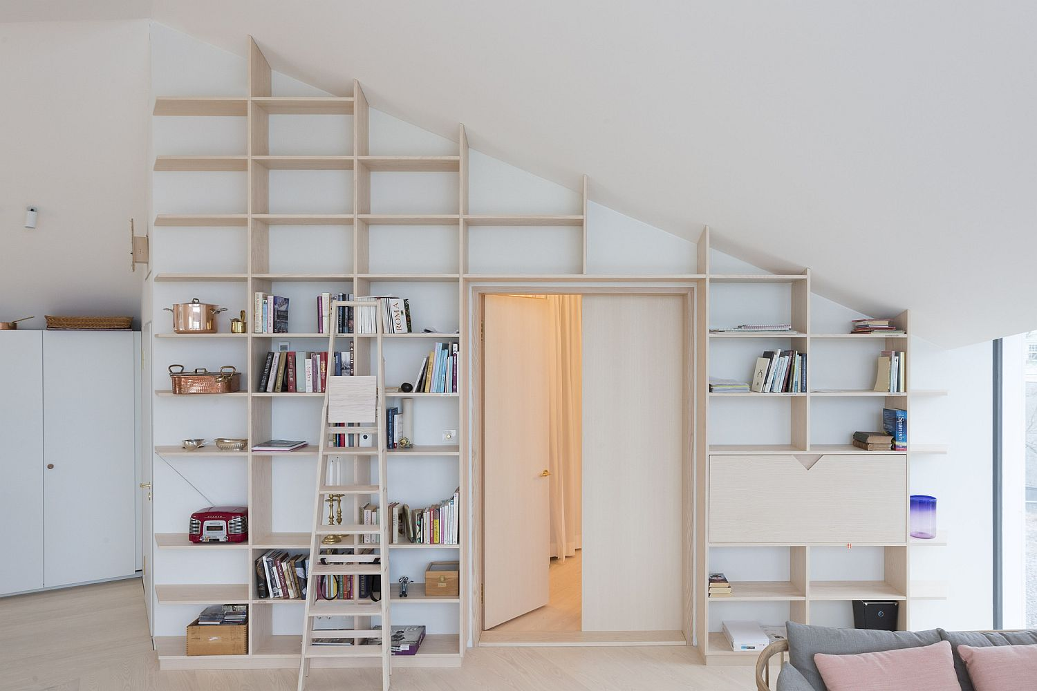 Space-savvy wall shelves that reach all the way up to the ceiling