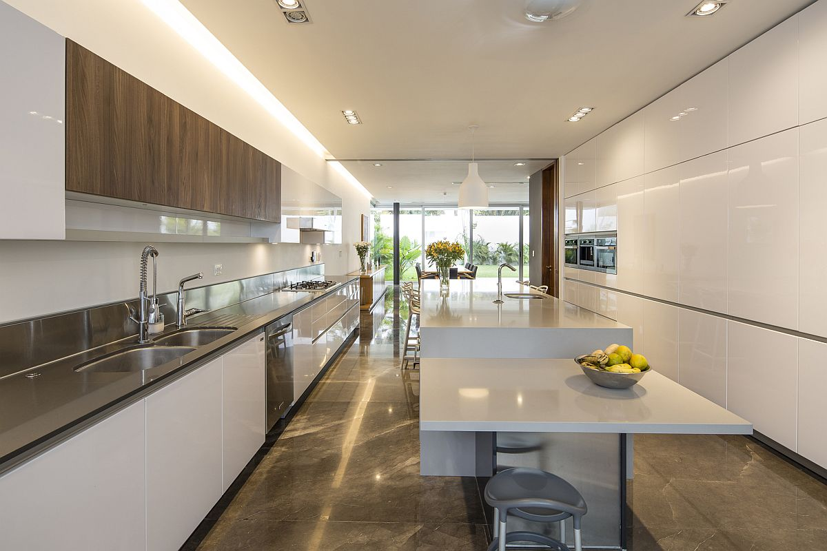 Spacious contemporary kitchen in white with a dashing breakfast bar