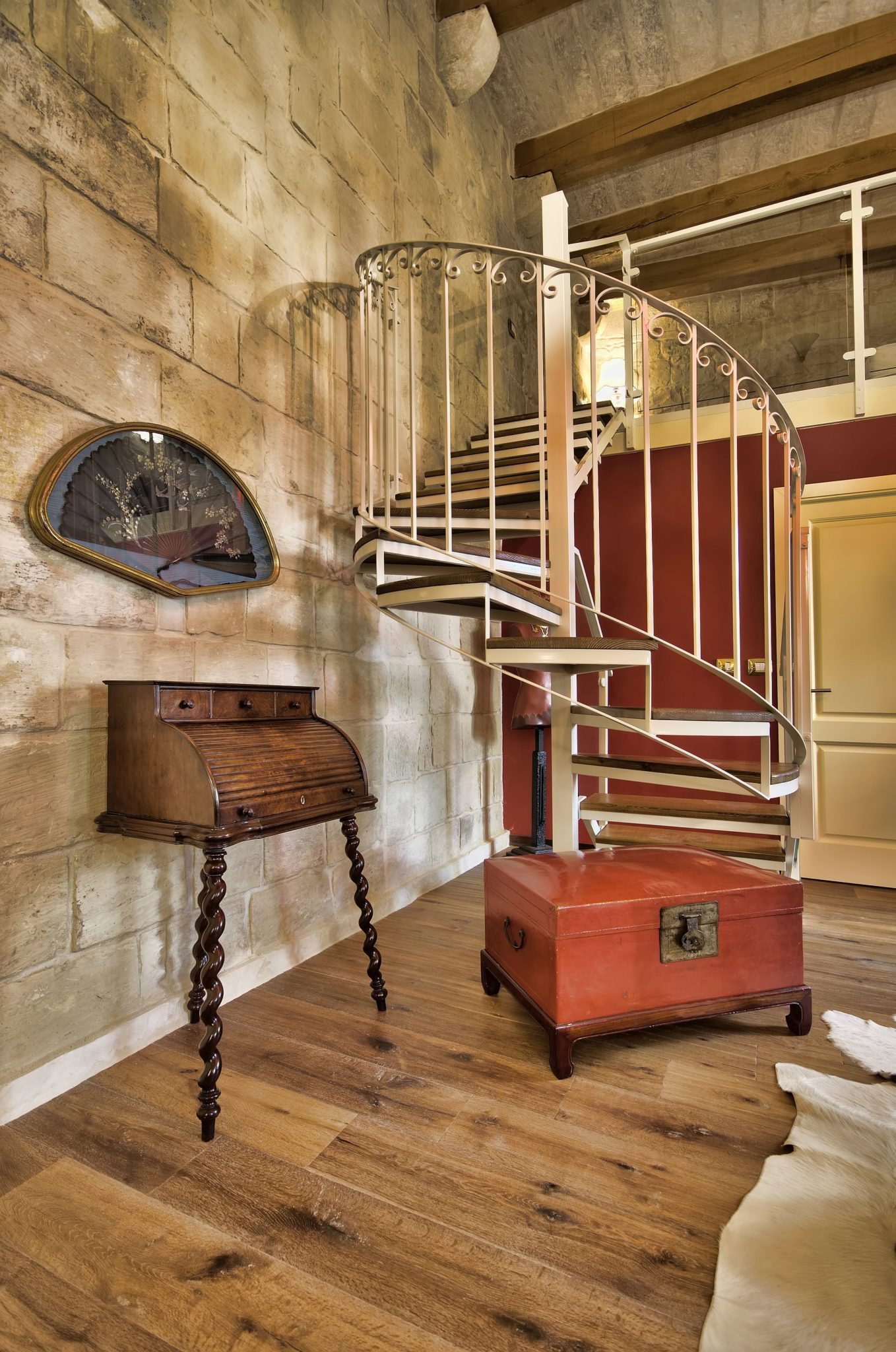 Spiral staircase leading to the aclove bedroom inside the first suite at Locanda La Gelsomina