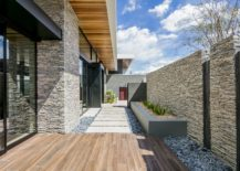 Stone-pathway-and-wooden-deck-of-the-Las-Vegas-home-217x155