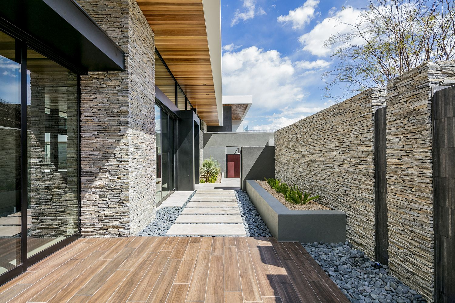 Stone-pathway-and-wooden-deck-of-the-Las-Vegas-home
