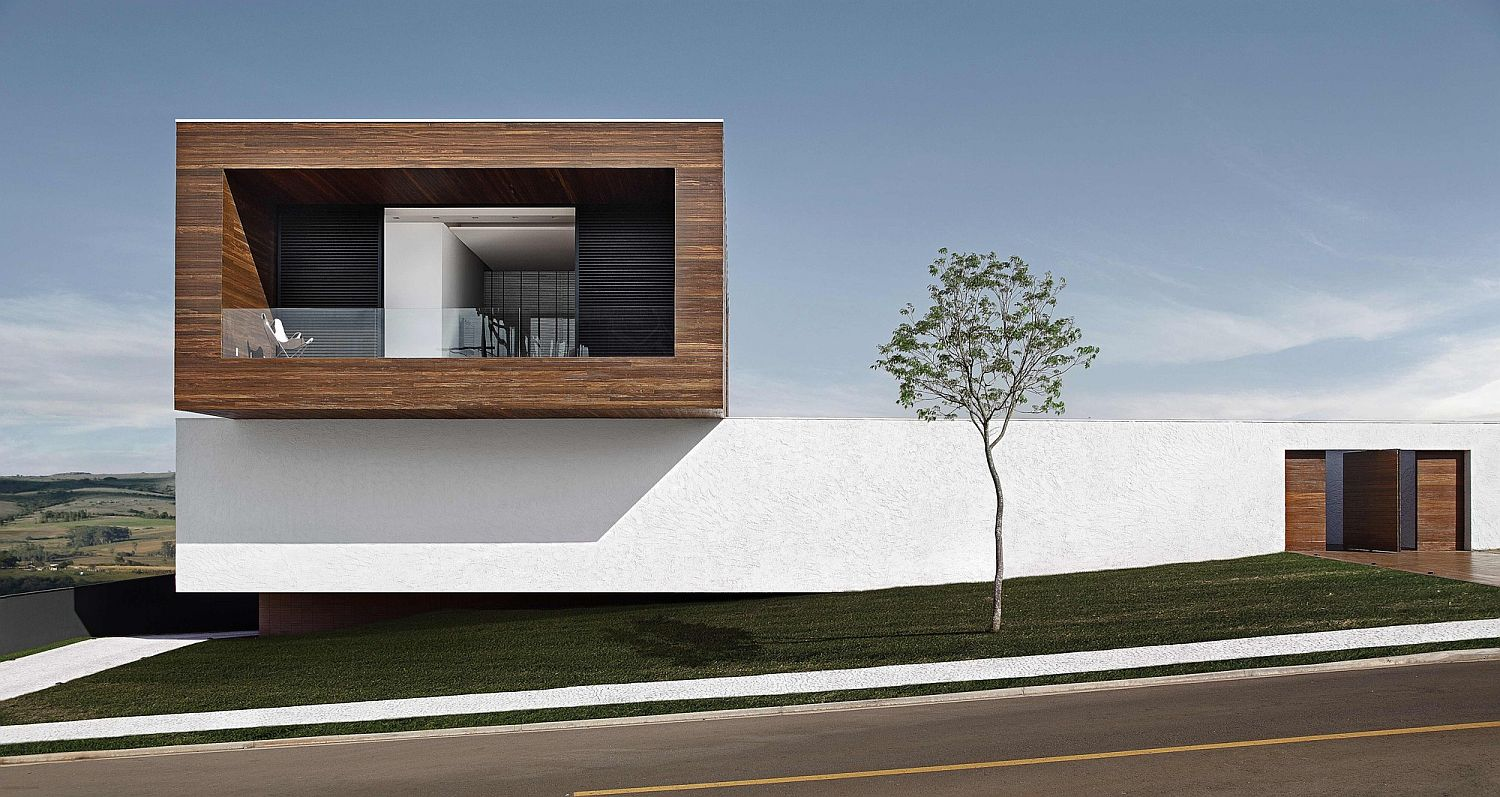 Street facade of the LA House in Brazil LA House: Cantilevered Brilliance Wrapped in Concrete and Wood