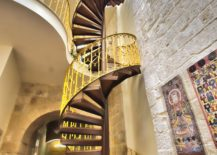 Stunning-spiral-staircase-inside-the-boutique-hotel-with-a-splash-of-yellow-217x155