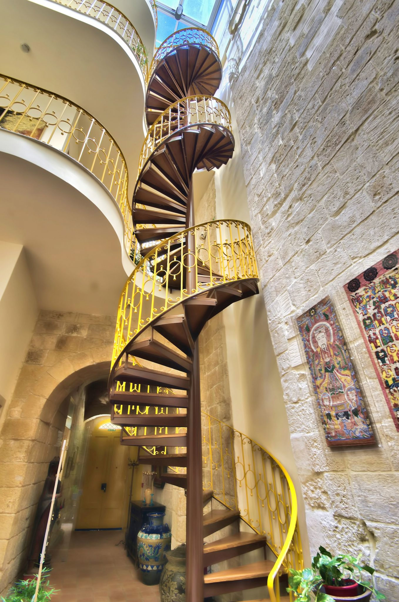 Stunning spiral staircase inside the boutique hotel with a splash of yellow