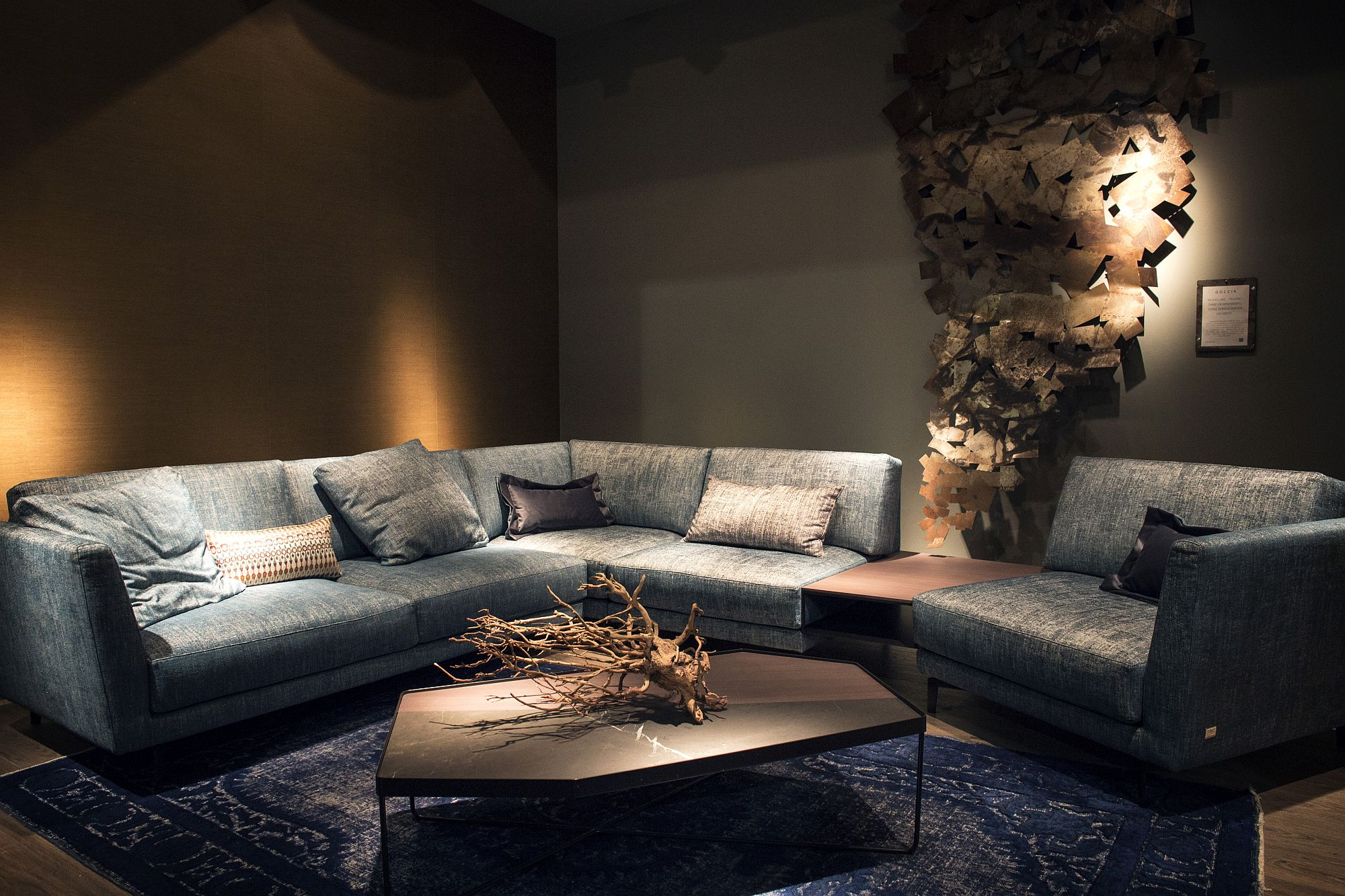 Subtle addition of color using the sofa adds to the appeal of the neutral living room