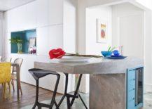 Super-cool-cement-kitchen-island-along-with-hexagonal-floor-tiles-217x155