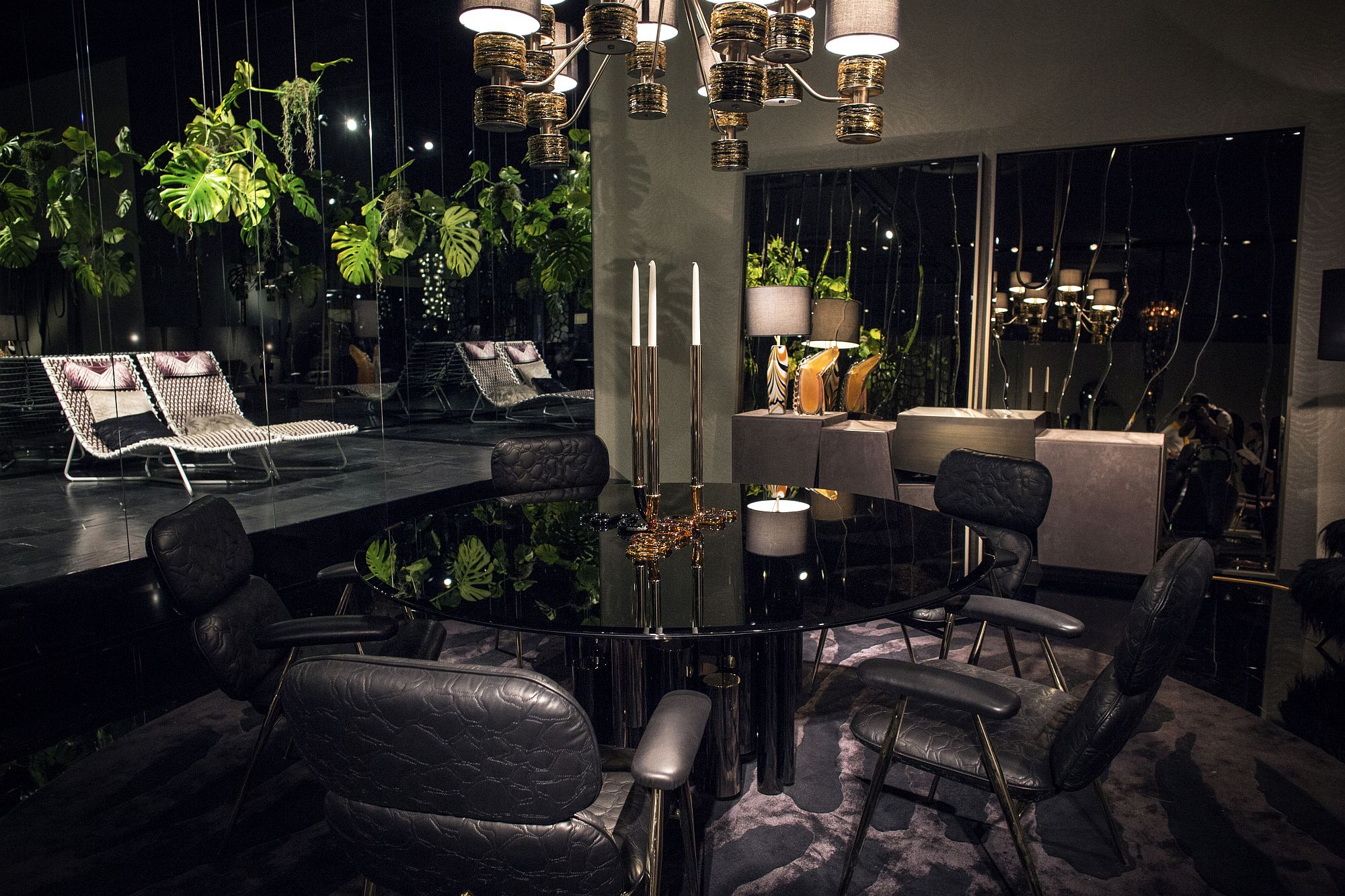 The black dining table becomes the focal point of the dining space