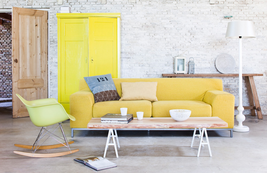 The yellow sofa contributes to colorful consistency