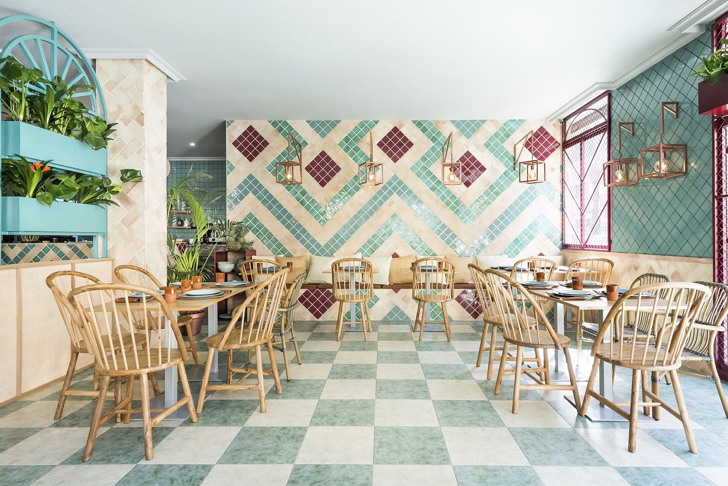 Tiled background and natural light help fashion a stunningly unique pizzeria