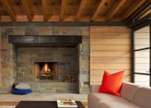 Traditional-stone-fireplace-surrounded-by-wall-with-wooden-slats-217x155