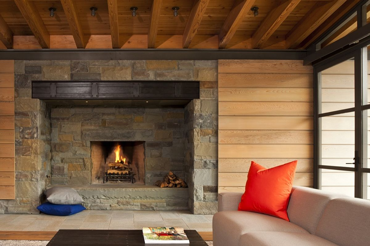 Traditional stone fireplace surrounded by wall with wooden slats