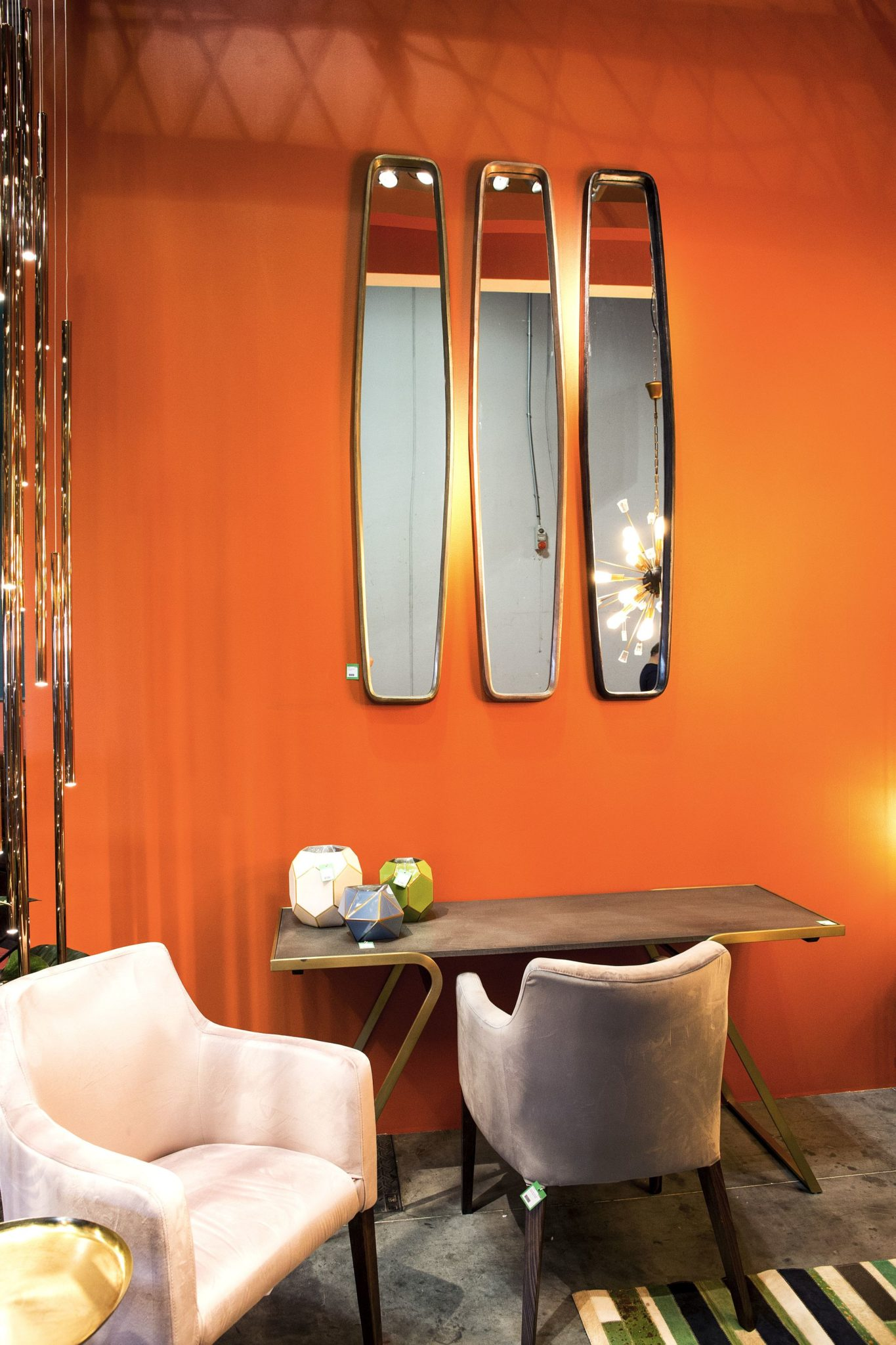 Trio of elongated mirrors with a dashing backdrop in orange