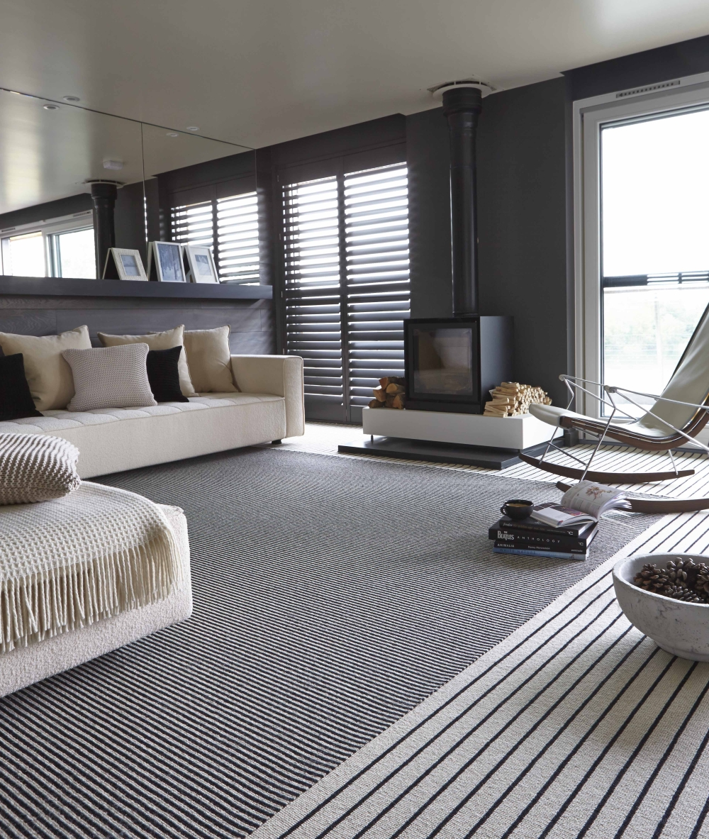 Two monochrome rugs with different stipes as unpredictable decor