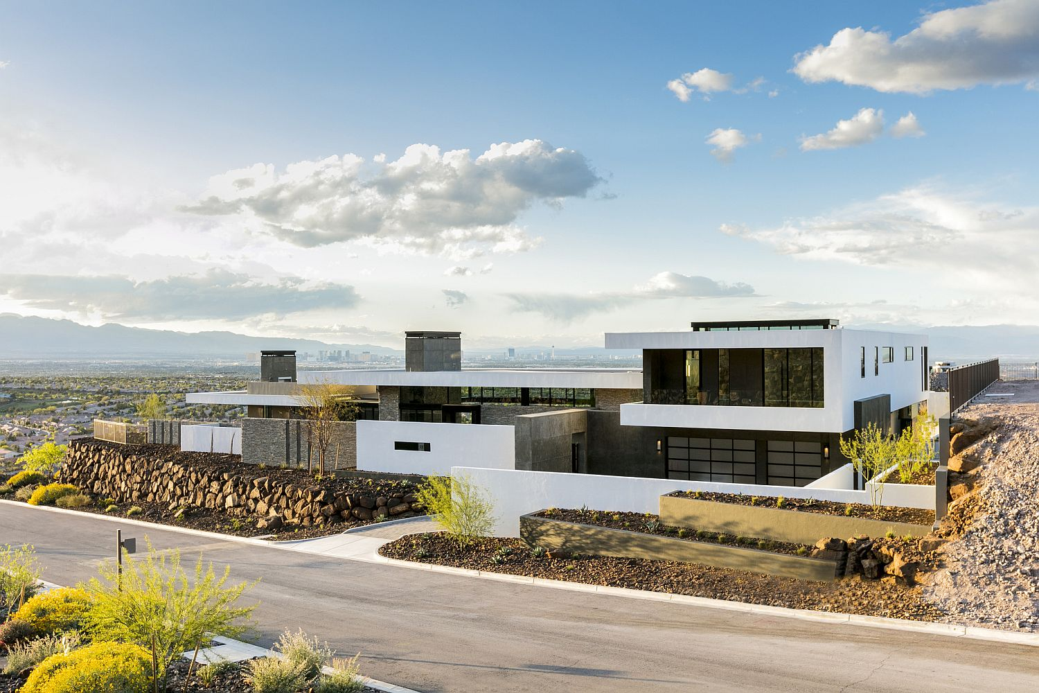View of the Ascaya from the street Contemporary Luxury Home with Vegas Shining Bright in the Distance!