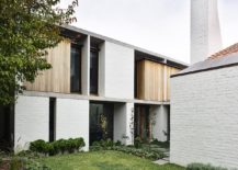 White-brick-exterior-and-chimneys-give-the-home-a-classic-vibe-217x155