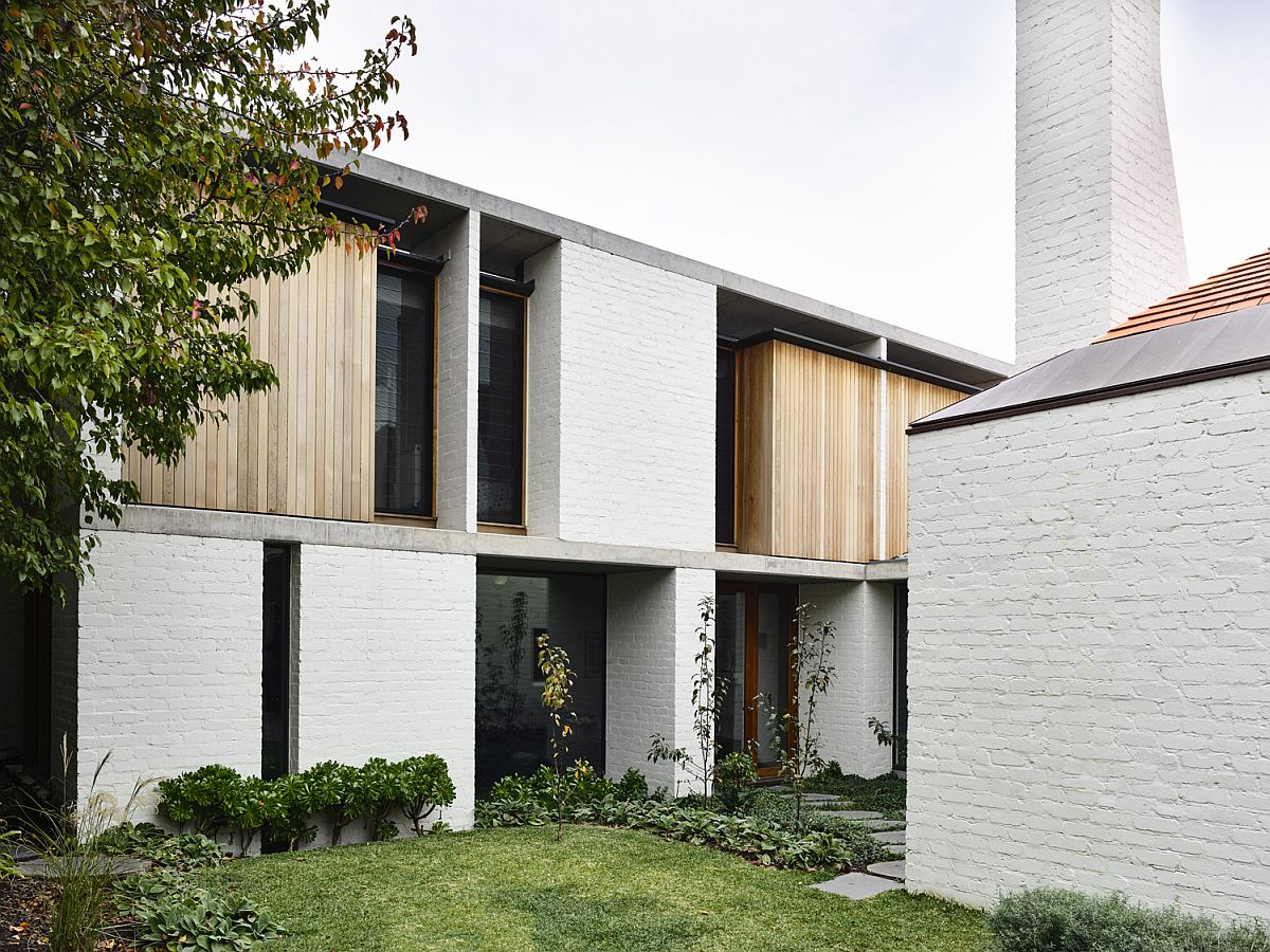 White-brick-exterior-and-chimneys-give-the-home-a-classic-vibe