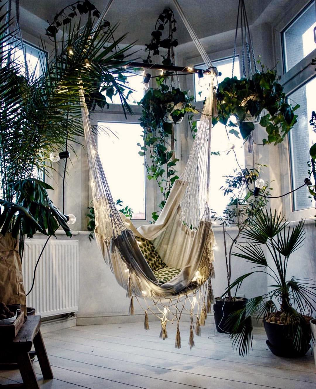 White hammock chair with string lights