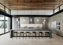White-kitchen-with-stone-countertop-for-the-kitchen-island-217x155