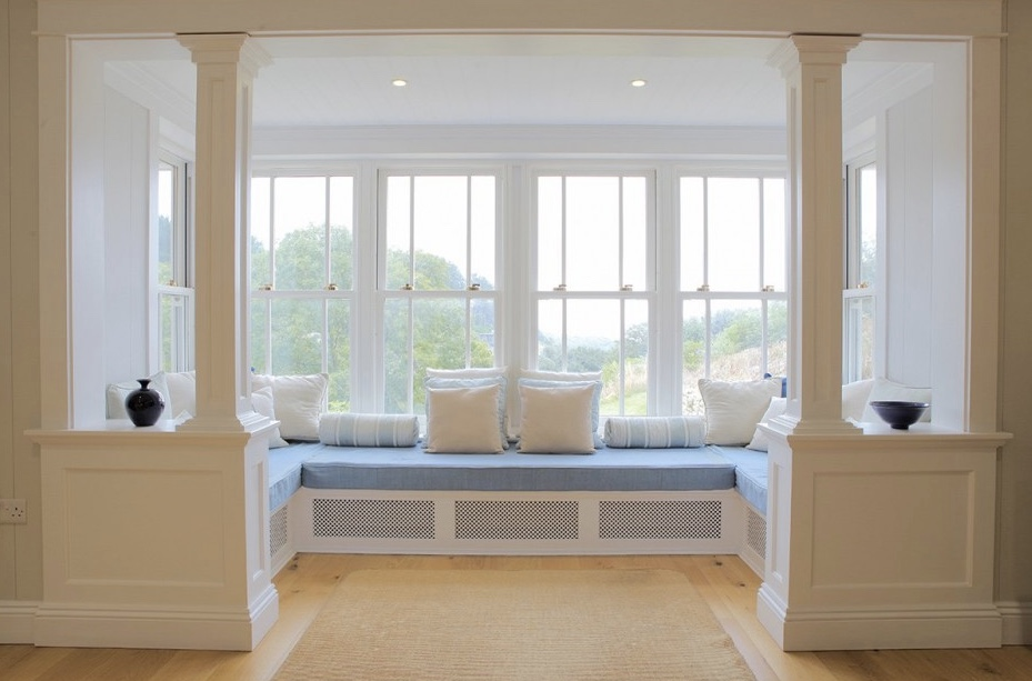 Window seat with a gentle color palette of white and soft blue