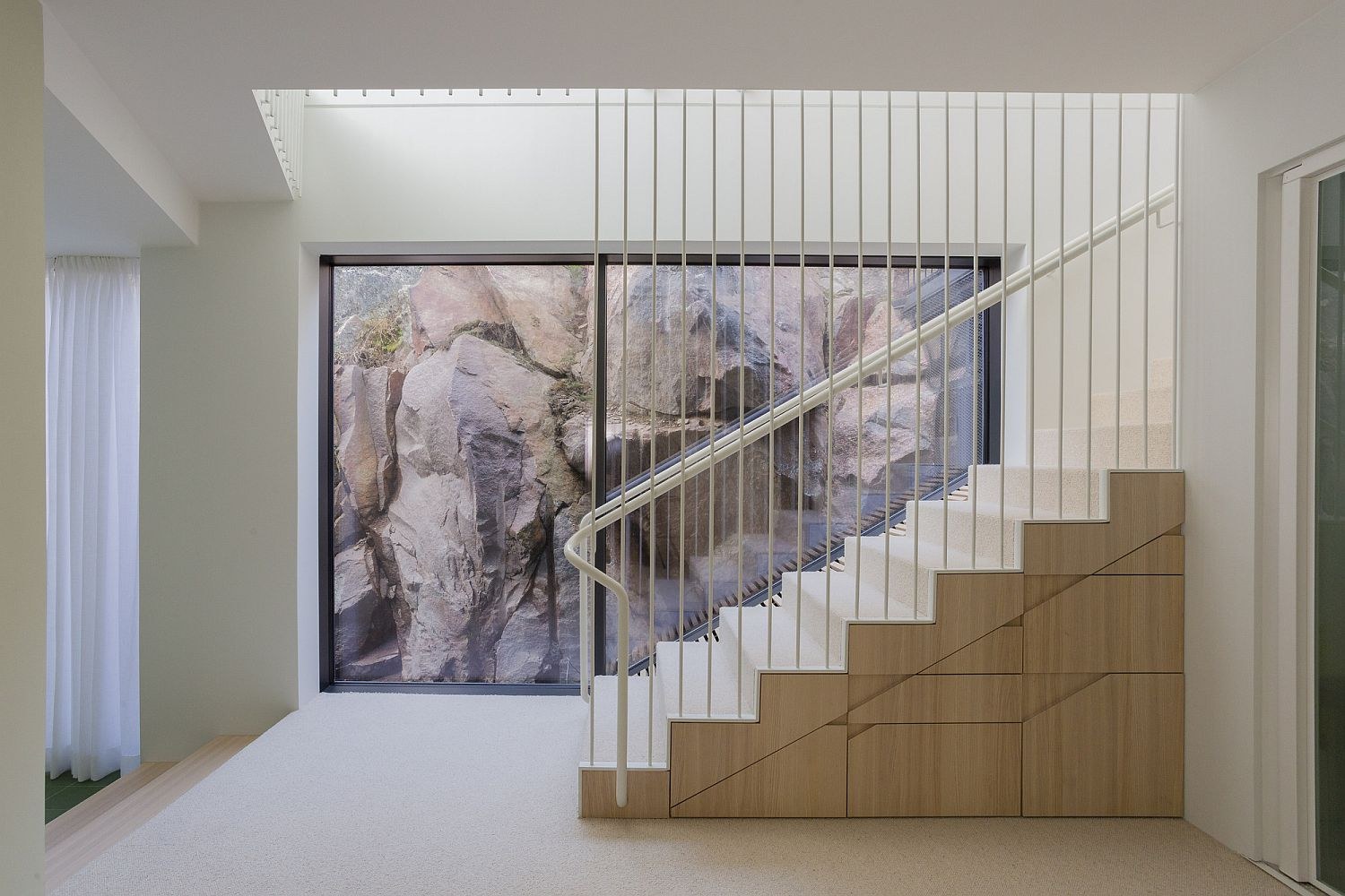 Wooden blocks with built-in storage used to create a lovely staircase
