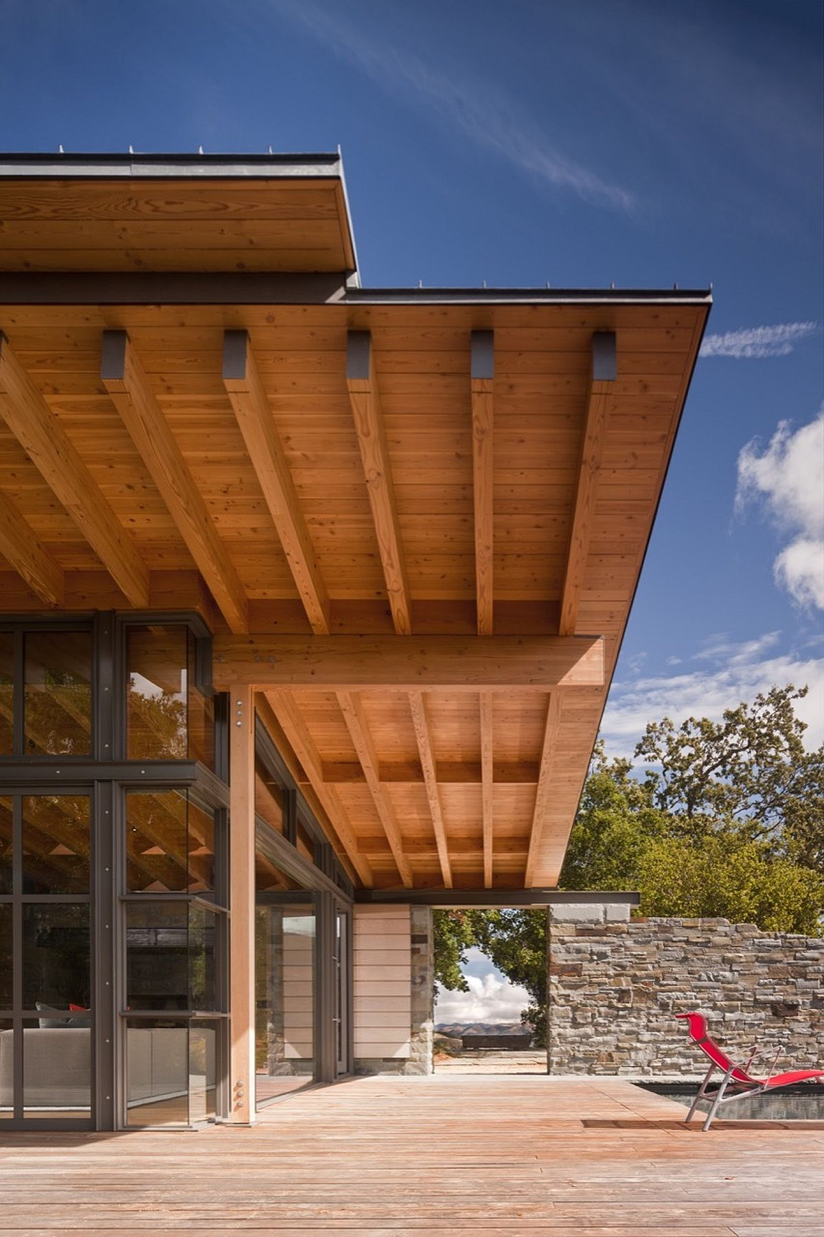 Wooden overhang offers natural shade to those on the deck
