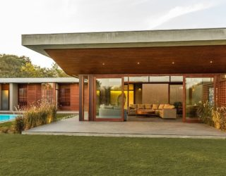 The Open House: Pavilion-Style Family retreat in Granite and Glass