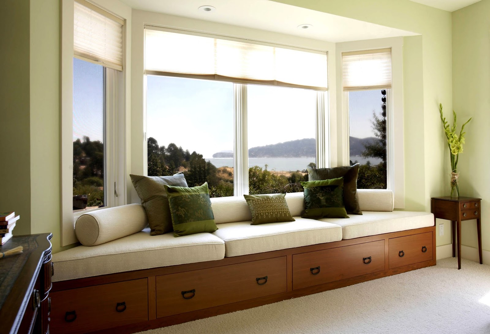 Wooden-window-seat-bench-with-olive-throw-pillows-