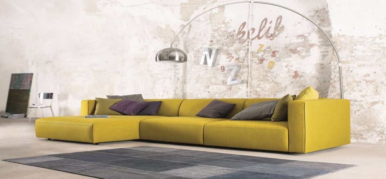 Yellow sofa stands out in an industrial room