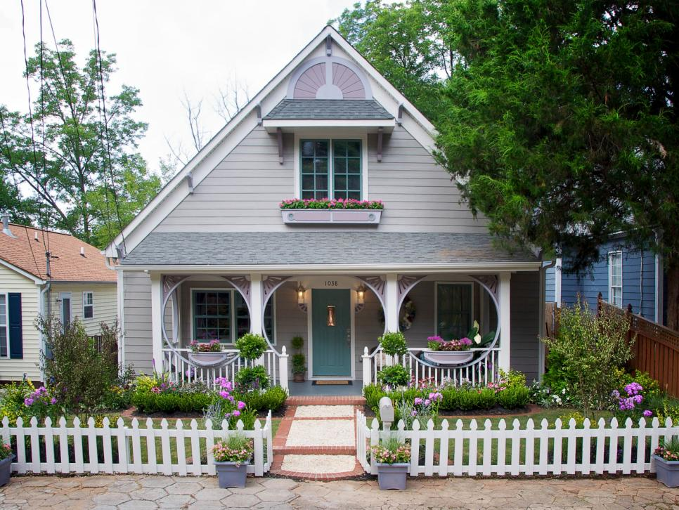 A charming little house with a white picket fence