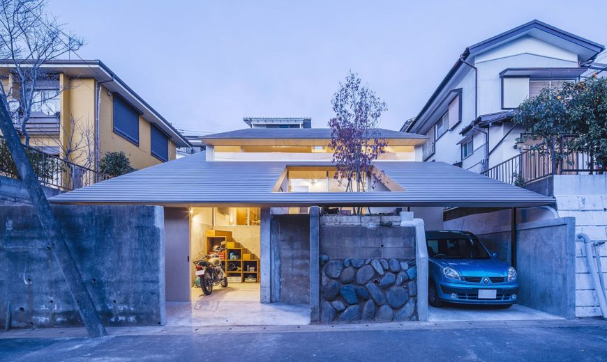Chic Japanese House Integrates Old Retaining Wall With Woodsy Slanted Roof
