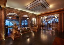 Asian-ethinic-motifs-and-carved-wooden-entryways-at-the-luxury-French-chalet-217x155