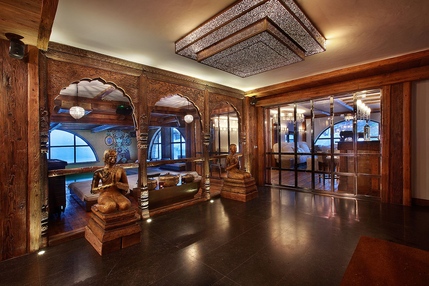 Asian ethnic motifs and carved wooden entryways at the luxury French chalet