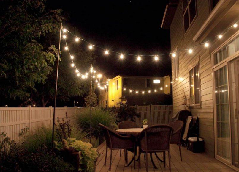Backyard illuminated by string lights