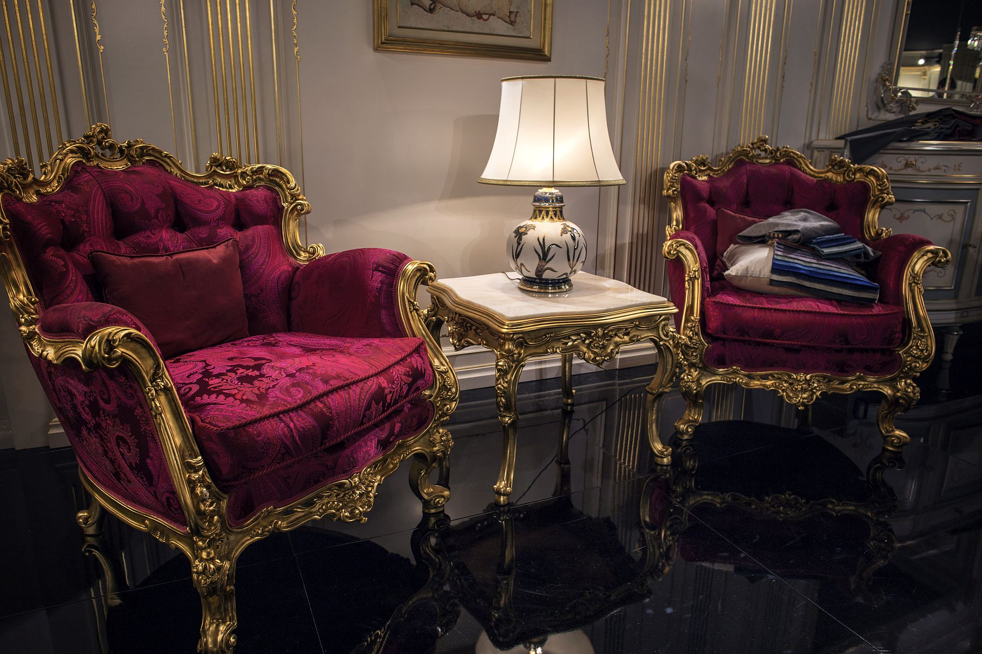 Beautiful-table-lamp-small-side-table-and-regal-chairs-create-a-traditional-conversation-nook