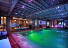 Beautifully-carved-wooden-beams-at-the-luxury-French-chalet-sit-in-contrast-to-contemporary-pool-space-217x155