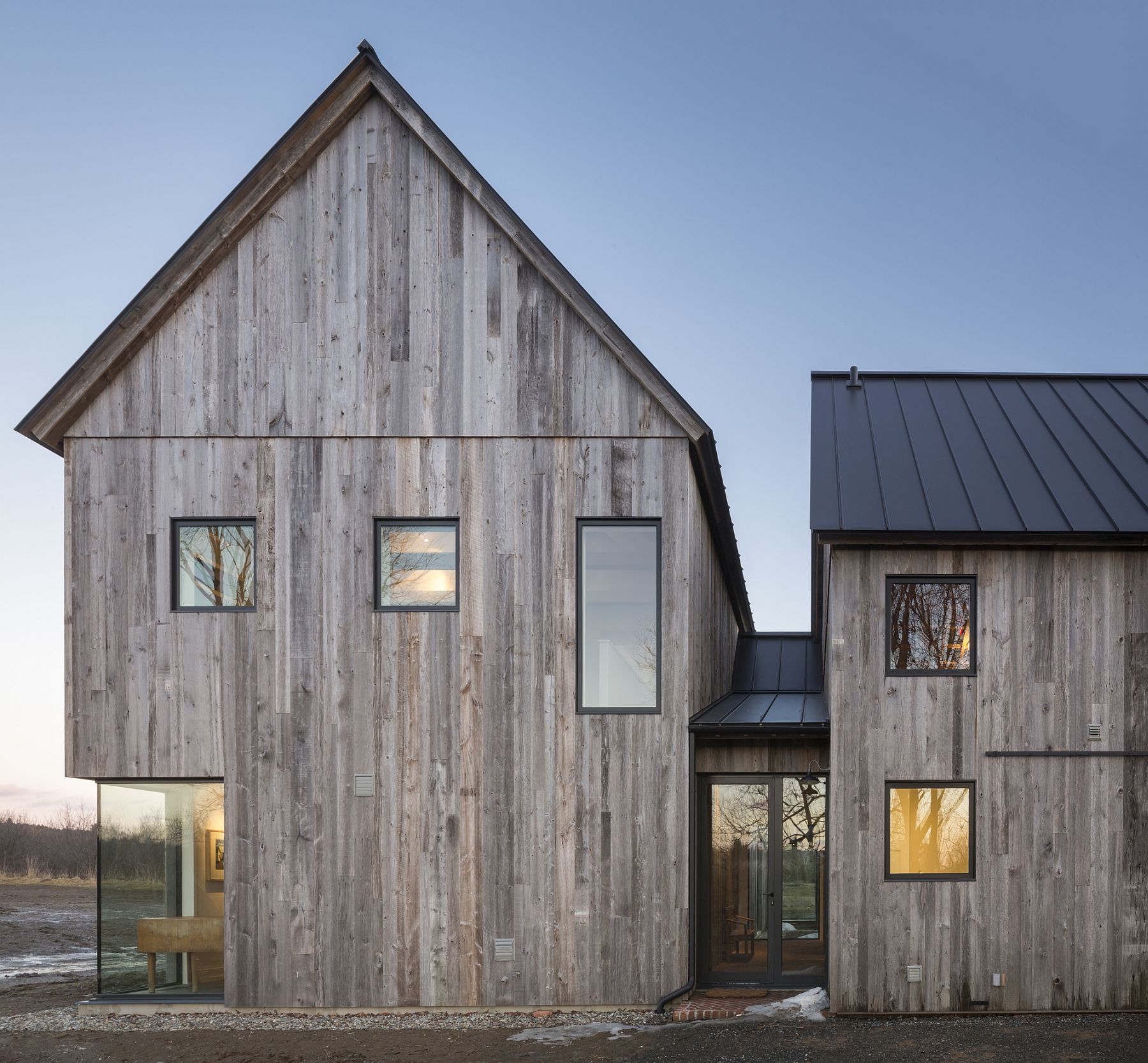 Townships farmhouse in quebec embraces modernity wrapped in rustic sheen for Modern rustic farmhouse exterior