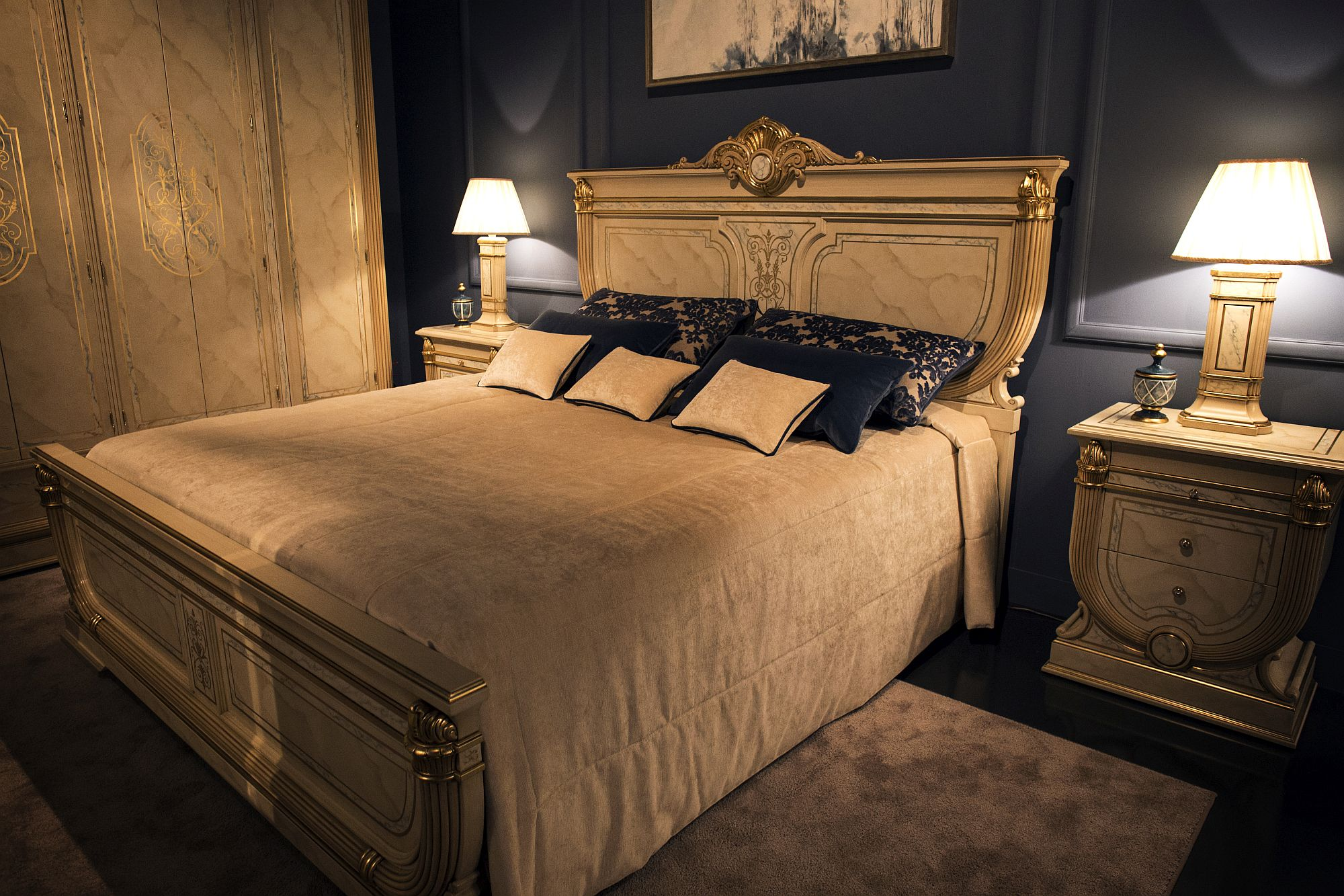 Bedside tables with matching table lamps for the lavish, traditional bedroom