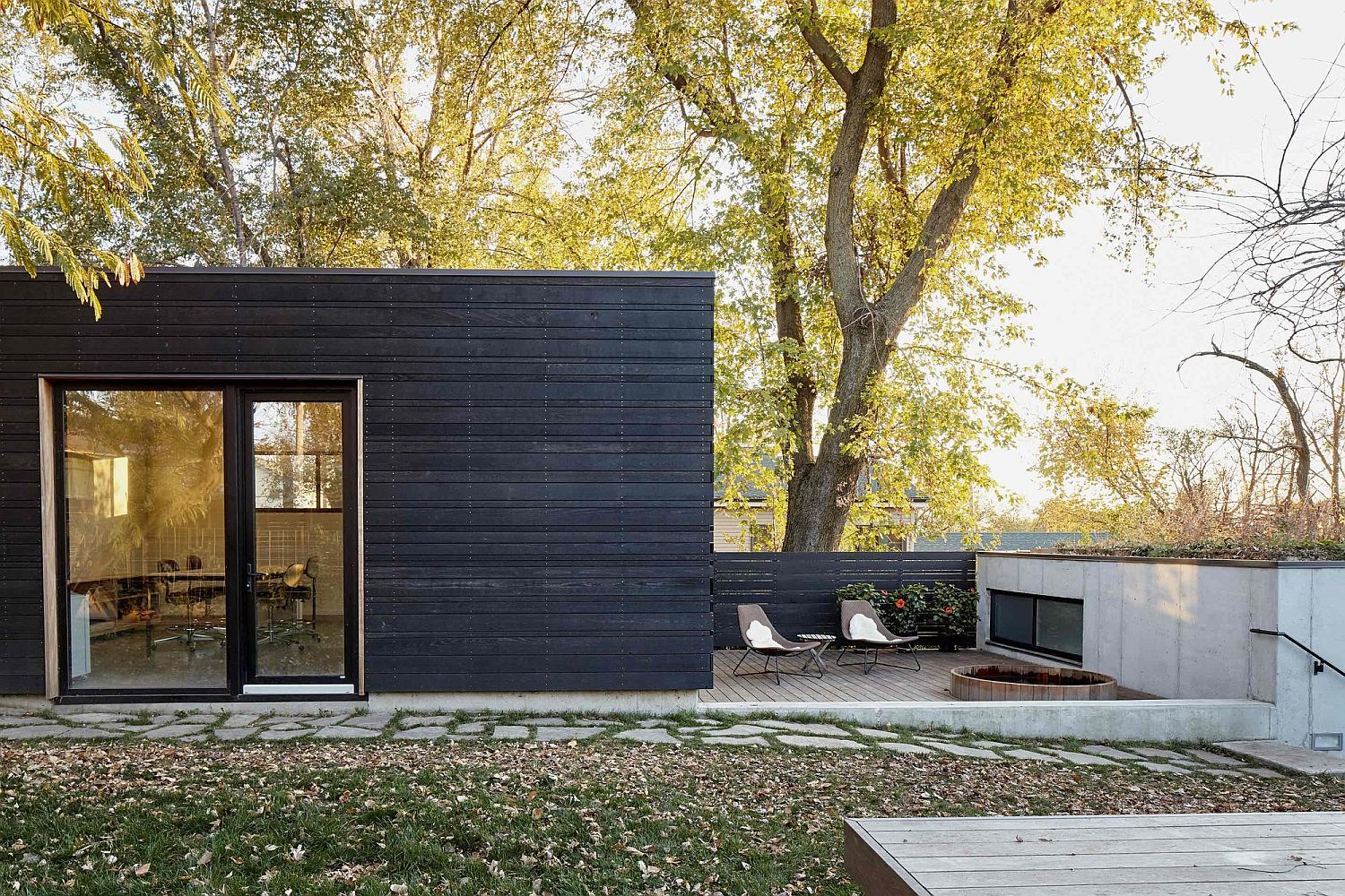 Black exterior and glass doors shape a stylish Kansas City home