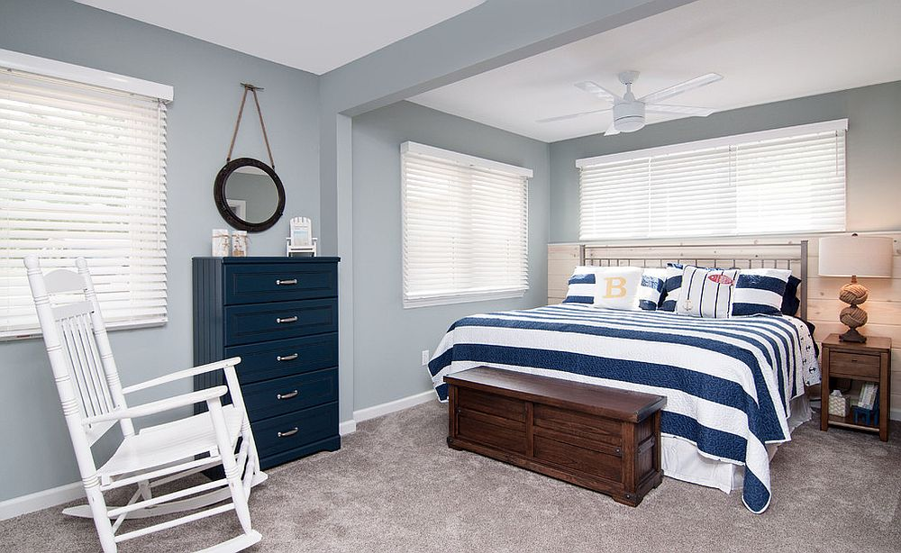 Bluish gray offers the perfect backdrop for a cheerful beach style bedroom