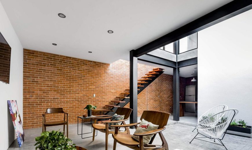 Exposed Brick Walls Steal the Show in this Modern Industrial Home!