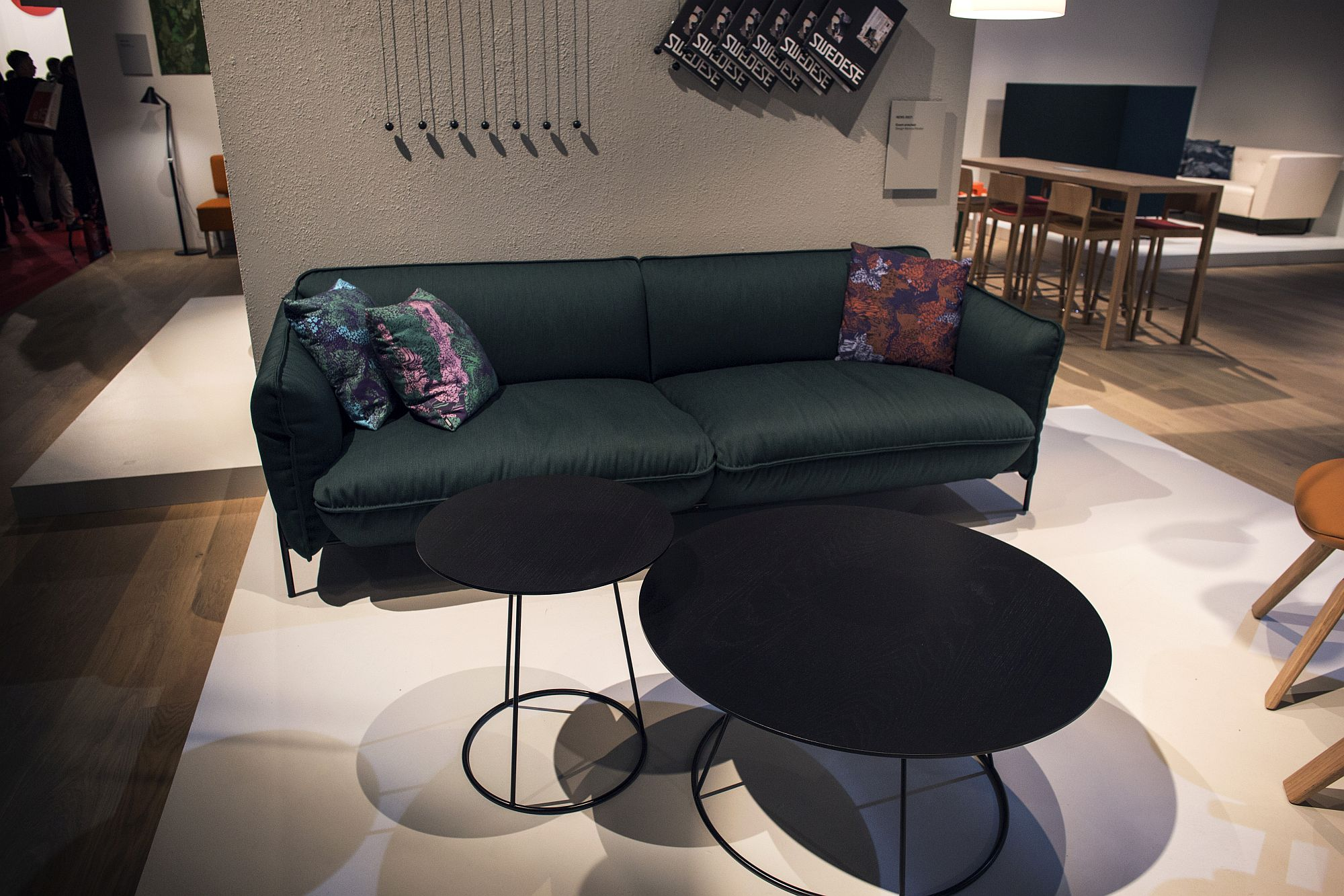 Combine smaller side tables and coffee tables to create a unique focal point in the living room