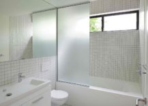 Contemporary-bathroom-in-white-tiled-walls-217x155