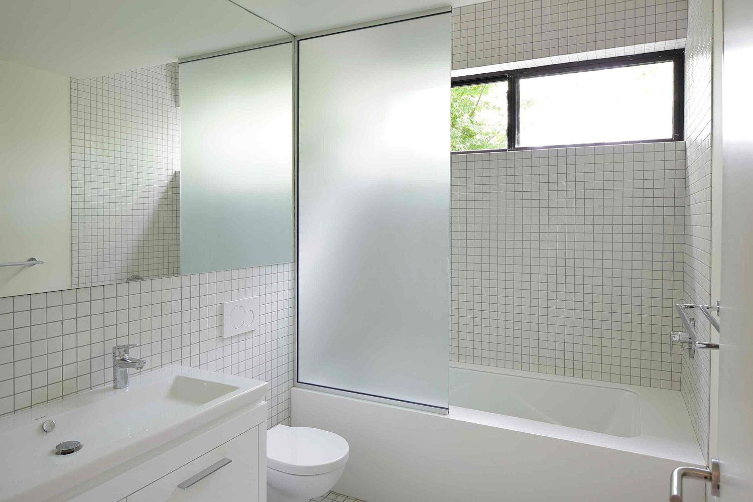 Contemporary bathroom in white tiled walls