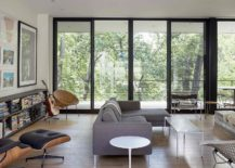 Contemporary-living-room-with-Eames-Lounger-and-a-stylish-bookshelf-217x155